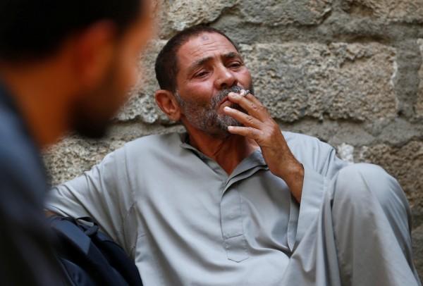 研究團隊指出,年老後戒菸可降低失智症發生機率。示意圖。(資料圖 路透)