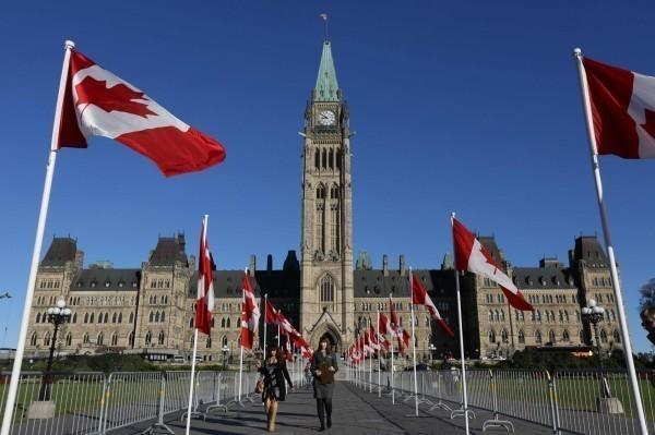 即便已移民自由開放的加拿大,許多中國移民仍活在無聲恐懼中。(路透)
