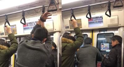 手穿過拉環搭電車好省力?日本男因此錯過站...