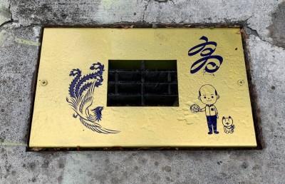 韓國瑜市政再度0分?排水孔蓋設計裝飾自己卡通人像