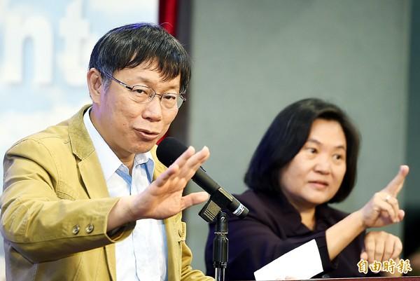 台北市長柯文哲(左)。(記者方賓照攝)