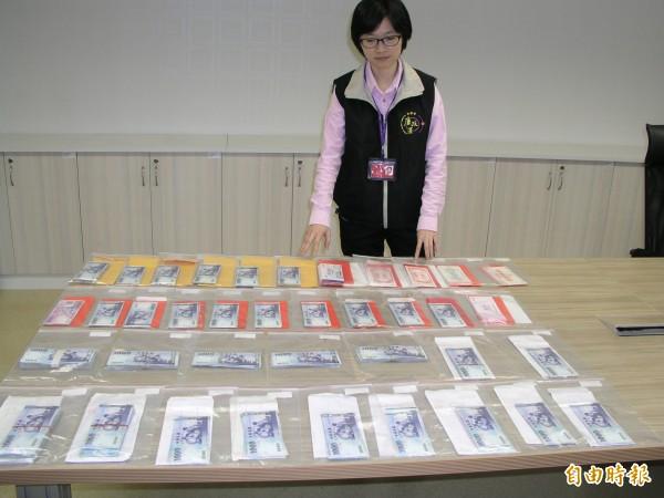 辦案人員查扣建管處副長李政賢住處疑上百萬賄款。(資料照,記者鮑建信攝)