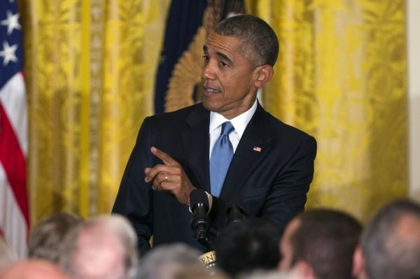 歐巴馬指責該名抗議者,「這是我家,這種行為非常不尊重人」。(美聯社)