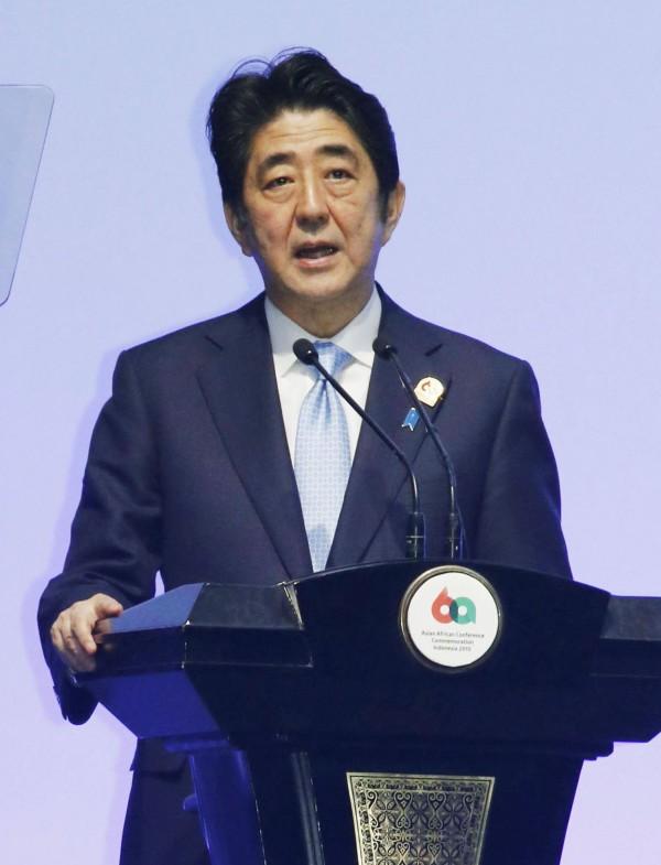 問卷調查,有九成日本憲法學者表示《安保法》違憲。圖為日本首相安倍晉三。(中央社)
