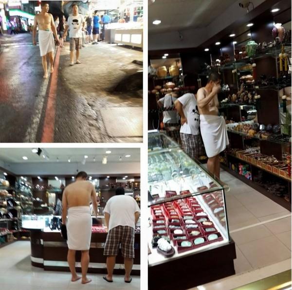 台東知本著名溫泉街上,驚見一名男子下身僅圍著浴巾、赤腳就出門逛大街,讓路過遊客表示好害羞。(圖擷取自爆料公社)