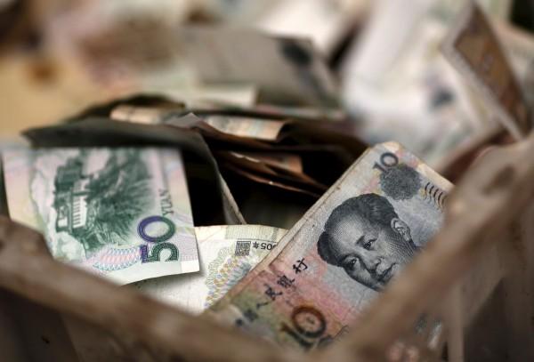美國官方指控中國洗錢嚴重,一年約達5億台幣。(資料照,路透)