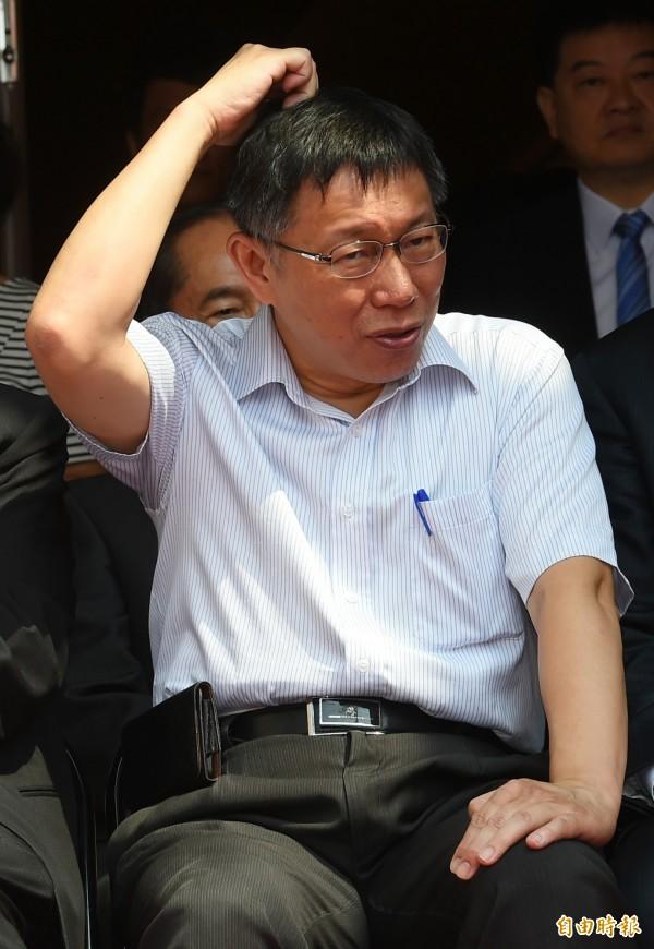 台北市長柯文哲在今日表示,餵野狗要像發街友便當一樣「定時定點餵」,此言一出再次引發爭議。(資料照,記者張嘉明攝)