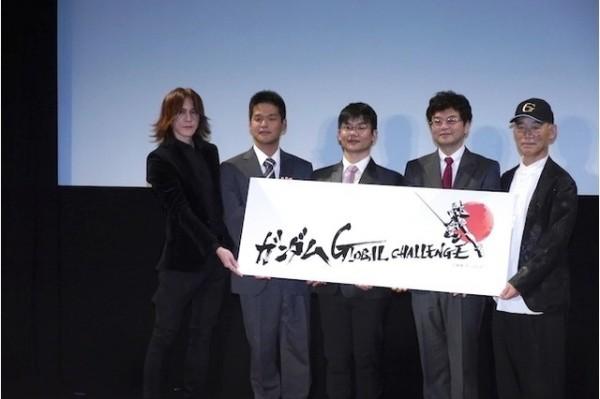 台大副教授江明勳(中)獲選「讓鋼彈動起來」入選方案之一。(圖截取自AnimeAnime網站)