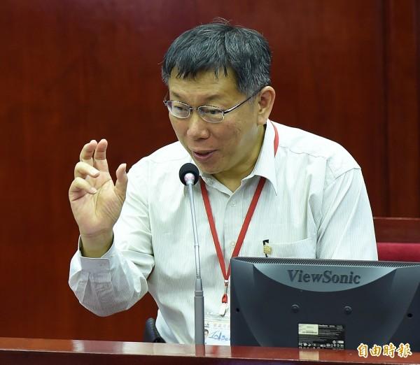 台北市長柯文哲9日至市議會備詢。(記者簡榮豐攝)