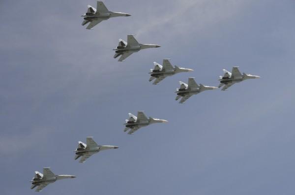 中國國防部發言人吳謙26日在例行記者會上證實,中俄在採購蘇愷-35戰機的合作項目已取得階段性成果。(路透)