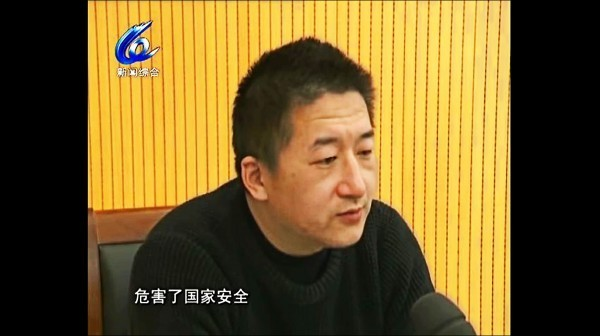 圖為中國維權律師張凱25日晚間出現在溫州電視台「認罪」。(取自網路)