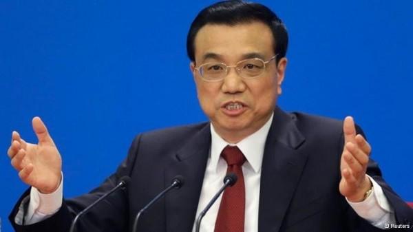 中國國務院總理李克強在今日發表的2016年政府工作報告中,針對兩岸議題重申「九二共識」。(路透)