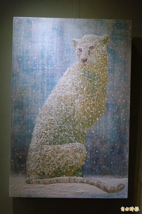 雪中豹影展現孤獨及保護色。(記者黃文鍠攝)