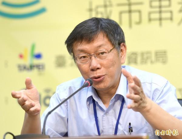 關於公宅計畫,北市府發言人林鶴明表示,市府一定會跟各地里民做深入溝通。圖為北市長柯文哲。(資料照,記者方賓照攝)