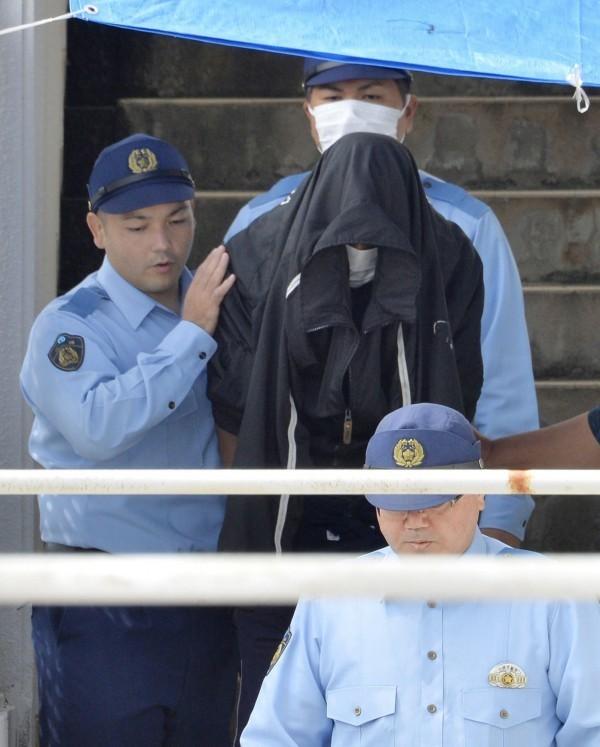 日本沖繩於4月底傳出20歲少女麗奈遭人姦殺後棄屍的案件,美軍雇員辛扎托於上月19日因涉嫌棄屍遭警方逮捕。圖為兇嫌辛扎托。(資料照,共同社)