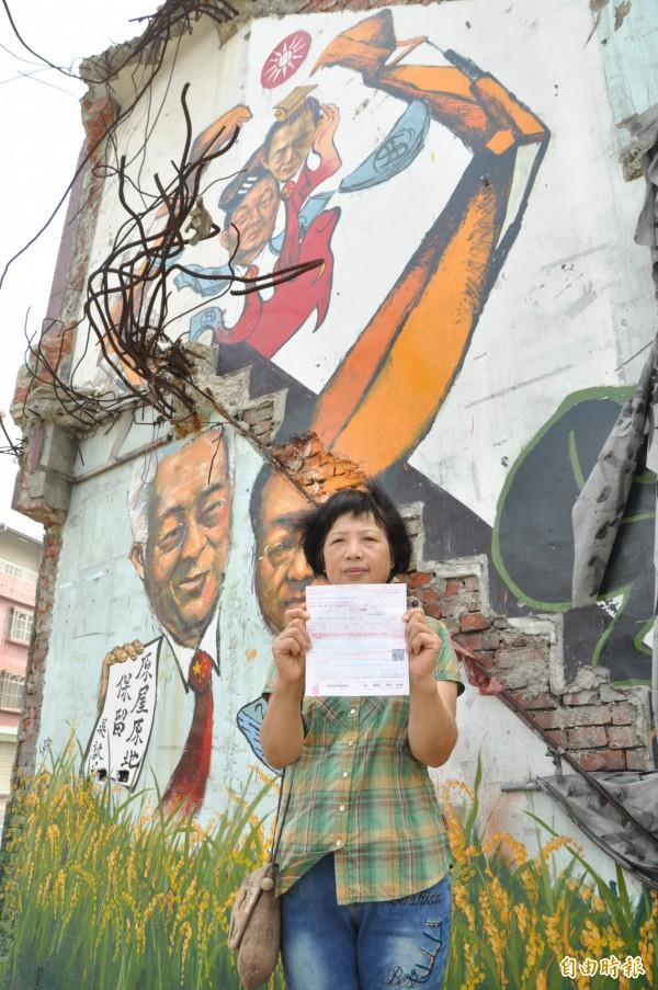 三年前的今天,大埔張藥房遭到強拆,屋主遺孀彭秀春表示,至今回想仍感到沉痛,並希望與等待重建的那一天到來。(資料照,記者彭健禮攝)