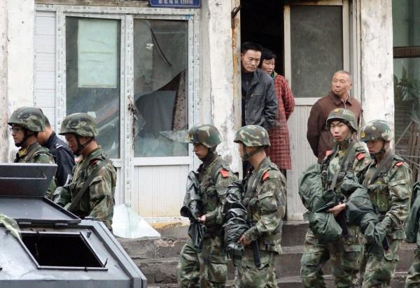 中國監管非政府組織在中國活動,並籍「維穩」打壓少數民族宗教信仰自由,將成為社會穩定隱憂。(美聯社)