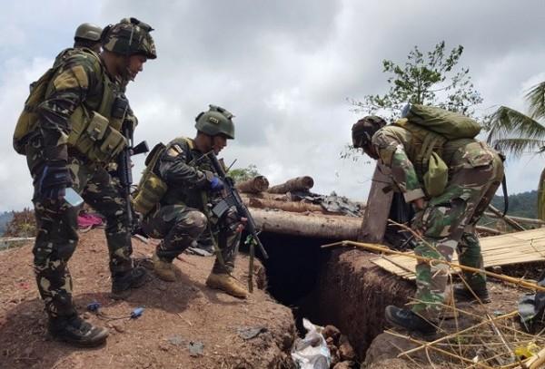 菲律賓特種部隊近日到菲國南部與叛軍組織激戰2天,最終攻下2座營地。(照片由西民答那峨島軍區公共事務處提供)