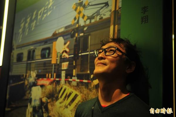 李翔從郵差搖身一變成為台南市官方指定攝影師,他說受到肯定感覺很好。(記者王捷攝)
