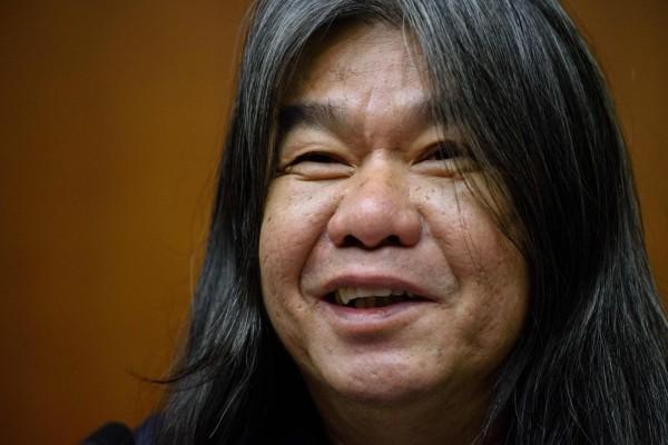 香港立法會議員梁國雄8日宣布投入特首選舉。(法新社)