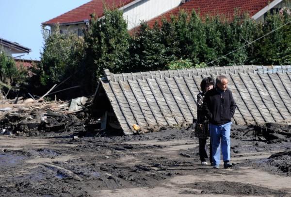 圖為日本福島遭遇311震災及海嘯後,街容面目全非。(資料照,法新社)