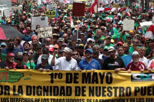 波多黎各人民於5月1日上街抗議。(路透)