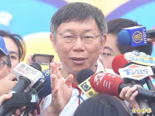 台北市長柯文哲7日出席第五屆愛天使樂活園遊會,會後受訪。(記者廖振輝攝)