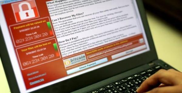 比特幣追蹤專家表示,散播勒索病毒的嫌犯,目前收到2萬美元左右的贖金(約新台幣60萬元)。(圖擷自《衛報》)