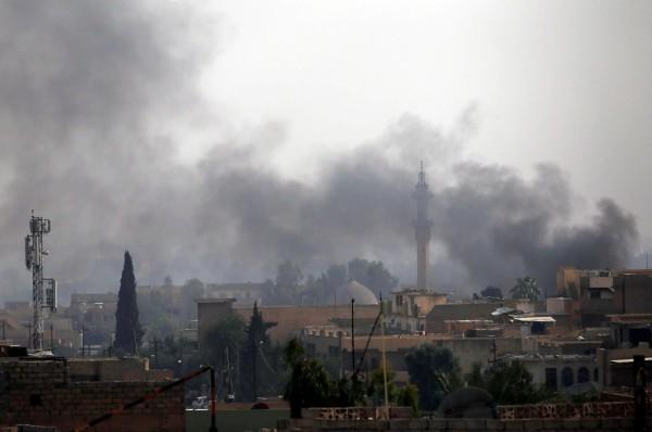西摩蘇爾舊城區仍在激戰中,伊拉克政府希望在月底收復西摩蘇爾。(路透)