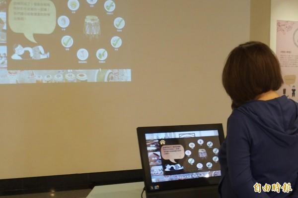 「新莊响仁和鼓文化特展」的《考鼓小學堂》多媒體互動體驗區,讓民眾在參觀後,可以來個成果大考驗。(記者葉冠妤攝)