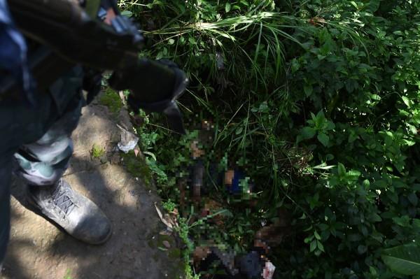 最近菲律賓南部發生恐怖組織動亂,有19位平民被穆斯林激進份子殺害。(法新社)