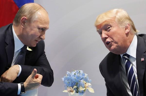 美國總統川普露與俄羅斯總統普廷的會談細節,表示雙方曾討論成立一個共同的網路安全機構,引發各界抨擊。(法新社)