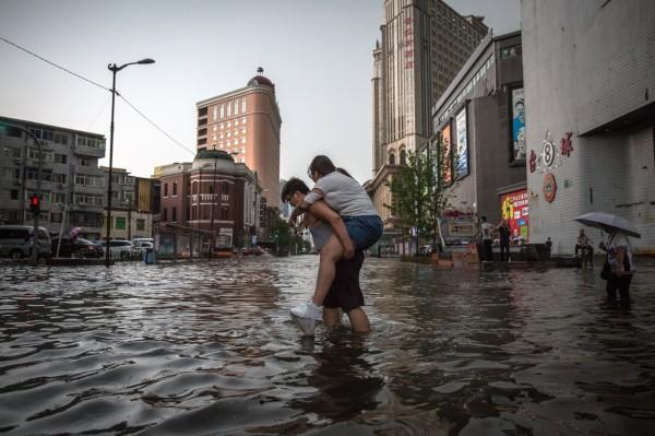 中國暴雨造成嚴重災害。示意圖。(歐新社)
