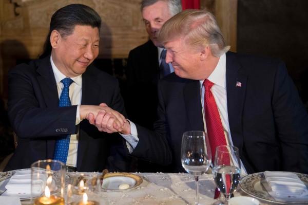 習近平今年7月與現任美國總統川普通電話後,中國官媒報導稱,習近平與川普談到對台議題,但事後由美國白宮公布的通話內容中,隻字未提涉台議題,通篇主軸是朝鮮半島核問題。(法新社)