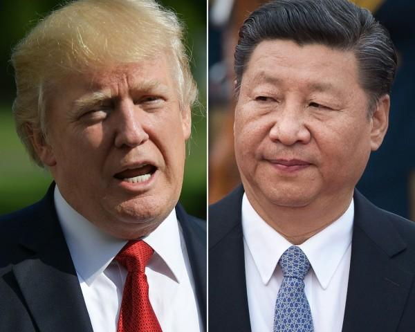 美國總統川普(左)下週將訪問亞洲,屆時將與中國國家主席習近平(右)會面。(法新社資料照)