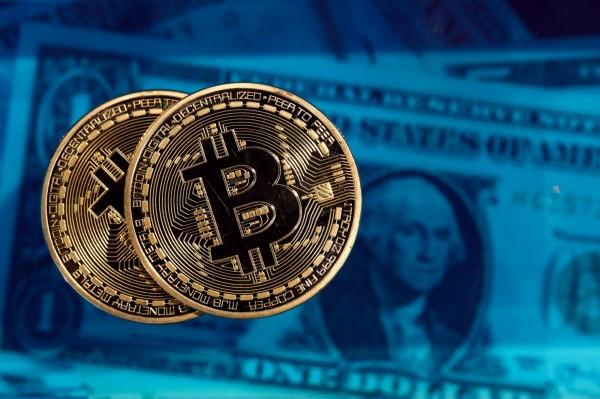 至今年10月底,比特幣在全球共有1170萬用戶,這個數字比去年同期的470萬暴增148%。(彭博)