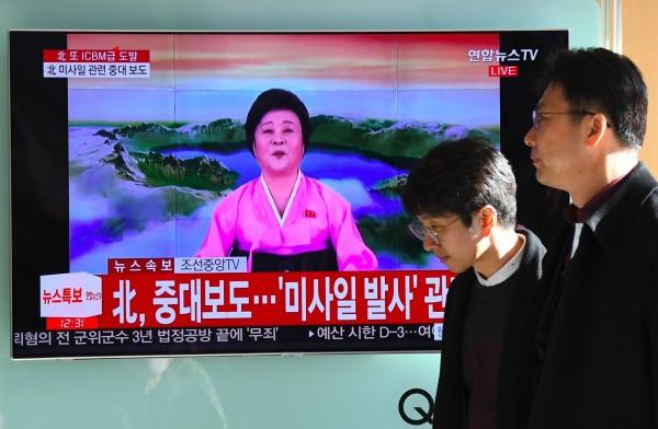 北韓「國寶主播」李春姬宣布,今天試射的「火星-15」洲際彈道飛彈取得成功,強調性能遠超「火星-14」。(法新社)