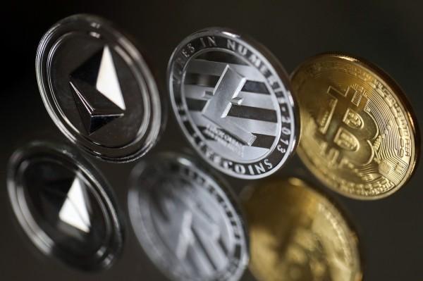 日本近期頻傳虛擬貨幣交易所出包,虛擬貨幣的安全性引發外界疑慮。(彭博)