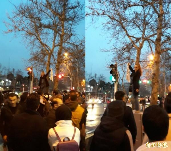 一名伊朗女子在德黑蘭繁忙的街頭,高舉著頭巾站上配電箱,抗議女性外出時必須戴頭巾的規定,當時現場有兩名警察要求她下來,其中一名警察更強硬將她從配電箱上推落。(圖擷自推特)