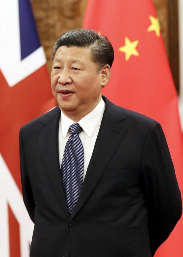 中國國家主席習近平(圖)擬透過修憲取消任期,師大教授范世平認為,他面臨的遭暗殺或政變的風險加劇。(歐新社)