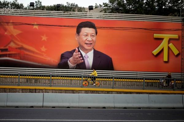 中國領導人習近平號稱嚴厲打貪,但中國全國人民代表大會、中國人民政治協商會議當中的153名成員,總資產竟然超過6500億美元(約新台幣19兆元)。(路透)
