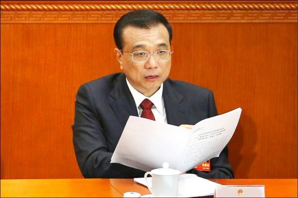 中國總理李克強昨在第13屆人民代表大會一次會議上發表政府工作報告。(歐新社)