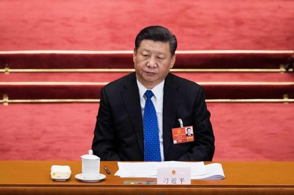 全面深化改革,是習近平治國的重點,也是他歷年兩會必談的話題。(法新社)
