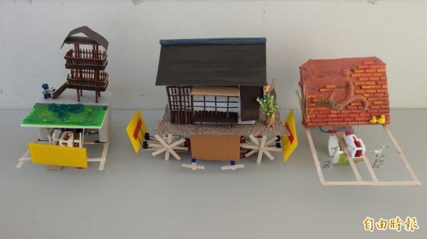 學童想到山腳國小就有知名的日治後期宿舍群,以及鄰近的磚雕和稻田彩繪,便將機器車打造成3個景點的樣子。(記者蔡政珉攝)