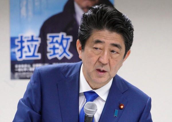 安倍晉三向文在寅要求,於文金會上談及北韓綁架外國人的問題。(美聯社)