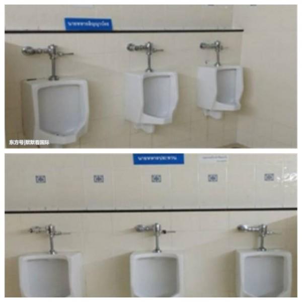 泰國一間醫院廁所內隔開小便斗,掛上標示牌要人按等級使用。(圖翻攝自雪花新聞)