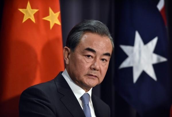 布吉納法索今日與中國復交,雙方外長已在北京簽署聯合公報。圖為中國外長王毅。(法新社)