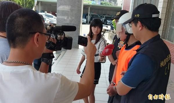 范姓男子被移送時,面對記者詢問不發一語。(記者謝武雄攝)