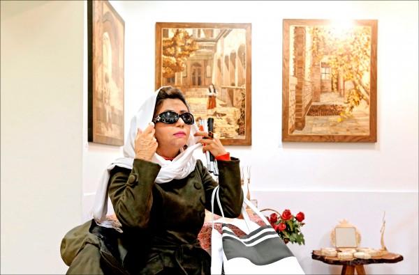 藉由藝術創作走出潑酸陰霾的伊朗女性瑪索梅.阿堤。(法新社檔案照)