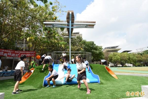 環團認為增加校園綠地與樹木,對於夏季降溫大有幫助。(記者劉曉欣攝)